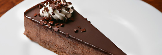 Image of a chocolate mudcake and cream